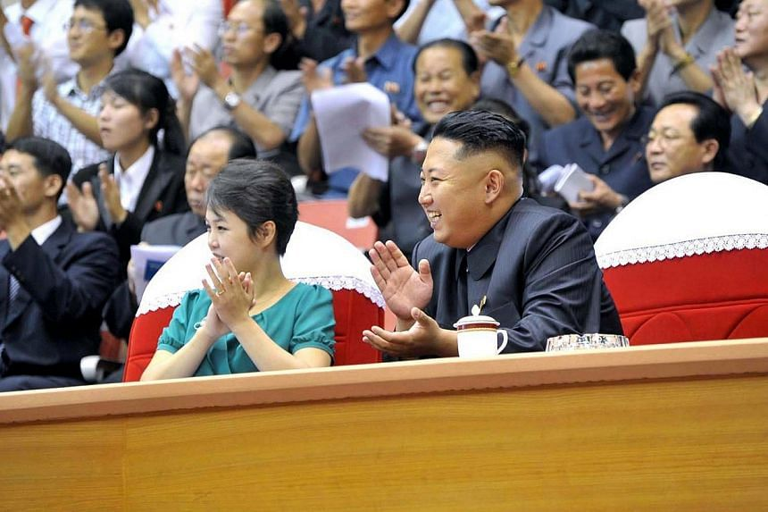 North Korean leader Kim Jong Un (right) and his wife Ri Sol Ju (left) watching a weight lifting meet in Pyongyang on Sunday, Sept 15, 2013. North Korea on Sunday angrily denied reports that it had executed several state performers to cover up th