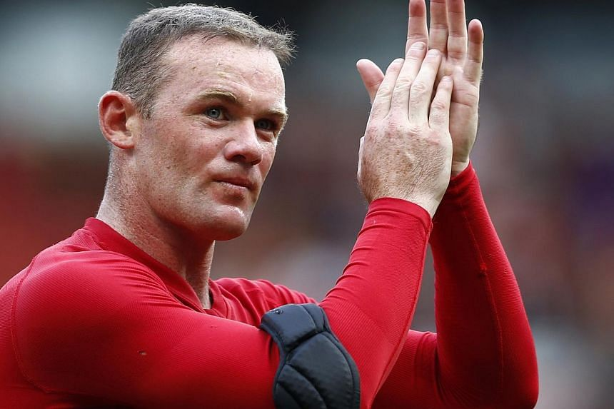 Manchester United's Wayne Rooney applauds after their English Premier League soccer match against Crystal Palace at Old Trafford in Manchester, northern England, September 14, 2013. Rooney was never close to joining Chelsea in the summer because Manc