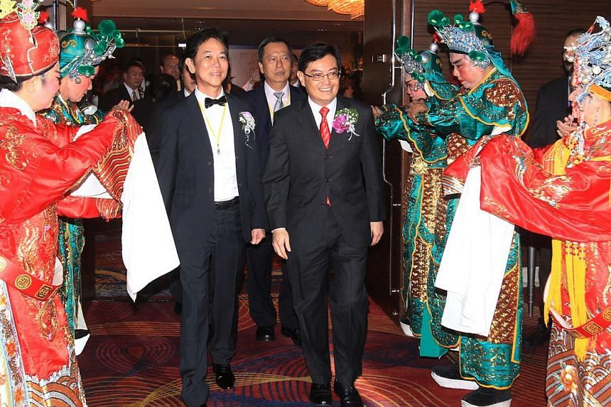 Mr Heng Swee Keat (right) is accompanied by Teochew Poit Ip Huay Kuan president George Quek as he arrives to attend the 84th anniversary event. -- PHOTO: LIANHE ZAOBAO