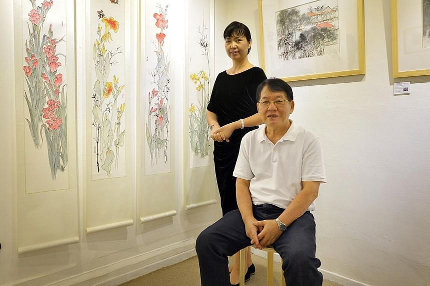 Chinese brush painter Goh Chiew Lye (seated) is staging a solo show at the Hai Hui Art Gallery at Tanglin Shopping Centre. With him is gallery owner Zi Juan. -- PHOTOS: BEYOND COLOURS, ALPHONSUS CHERN