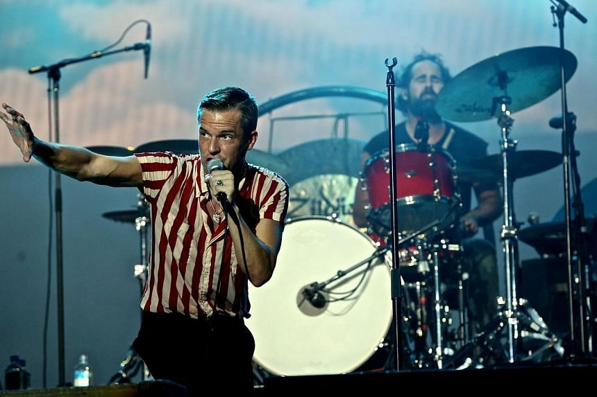 Frontman Brandon Flowers of American rock band The Killers, the headline act for the second night of the 2013 Formula 1 SingTel Singapore Grand Prix concerts, performs at the Padang Stage, Singapore, on Sept 21, 2013.-- PHOTO:TOREY PETER