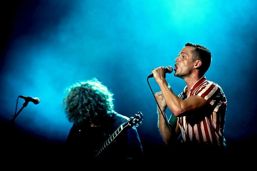 Frontman Brandon Flowers of American rock band The Killers, the headline act for the second night of the 2013 Formula 1 SingTel Singapore Grand Prix concerts, performs at the Padang Stage, Singapore, on Sept 21, 2013. -- PHOTO: TOREY PETER
