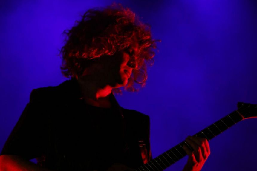 Lead guitarist Dave Keuning of American rock band The Killers, the headline act for the second night of the 2013 Formula 1 SingTel Singapore Grand Prix concerts, performs at the Padang Stage, Singapore, on Sept 21, 2013.-- PHOTO:TOREY PET