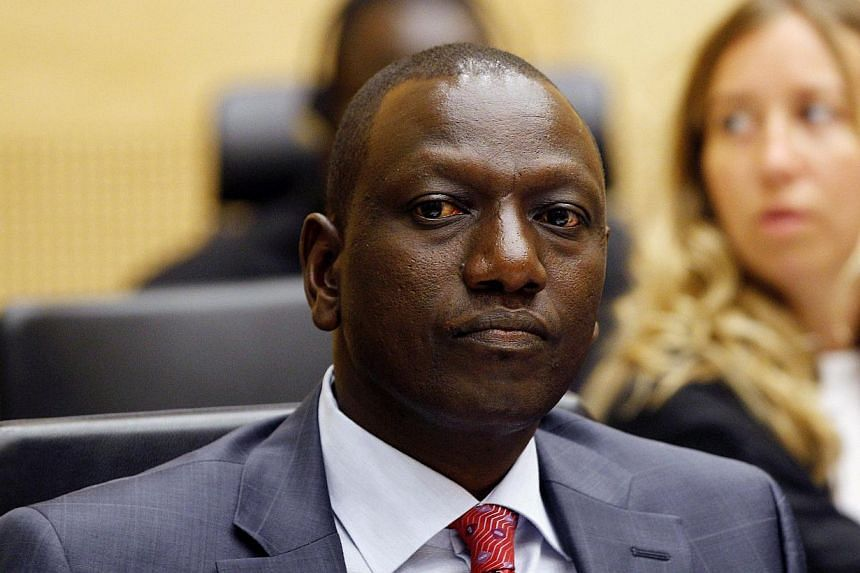 Kenyan Vice President William Ruto sits in the courtroom of the International Criminal Court (ICC) in The Hague, Netherlands. A lawyer for Ruto asked the International Criminal Court on Sunday to adjourn his trial for crimes against humanity because