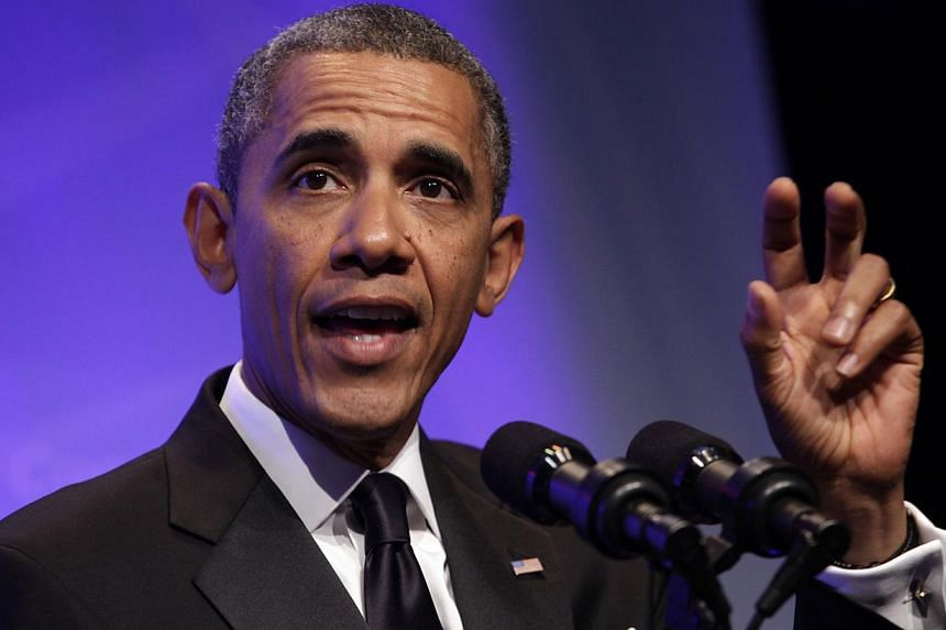 """US President Barack Obama delivers remarks at the Congressional Black Caucus Foundation Annual Phoenix Awards Dinner in Washington Sept 21, 2013. Mr Obama has urged supporters to """"go back at it"""" and pursue gun-control measures after mass shootings in"""