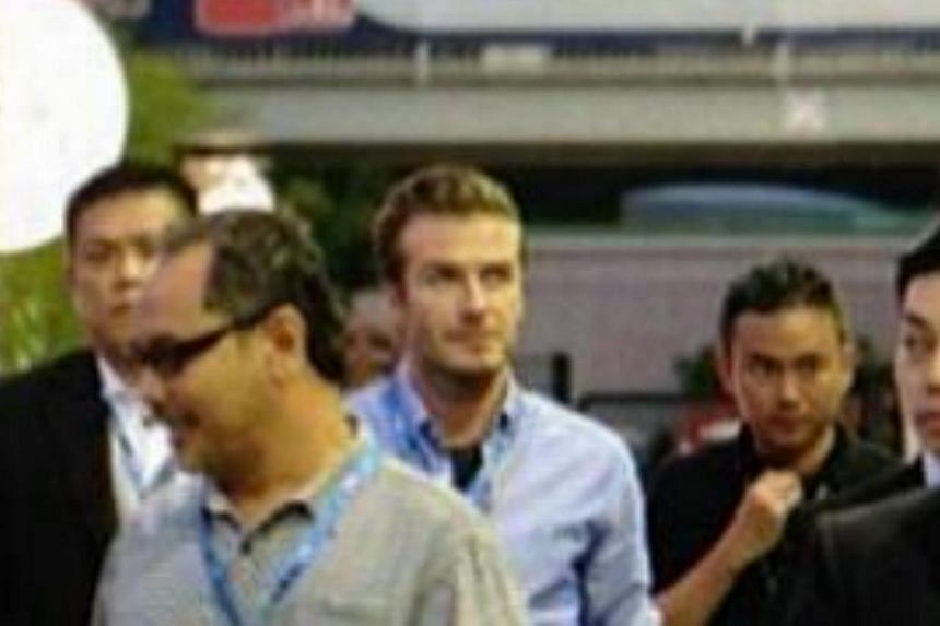 Former England football captain David Beckham made more than a few heads turn when he arrived at the F1 paddock. He was later spotted walking with F1 supremo Bernie Ecclestone. -- ST PHOTO