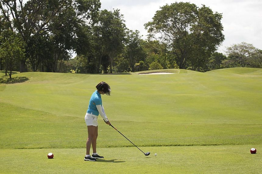 A golfer in action at the Tanah Merah Country Club, which is one of the golf courses speculated to be one of the clubs that may have to go in order to free up land for other users. -- ST FILE PHOTO:YEN MENG JIIN