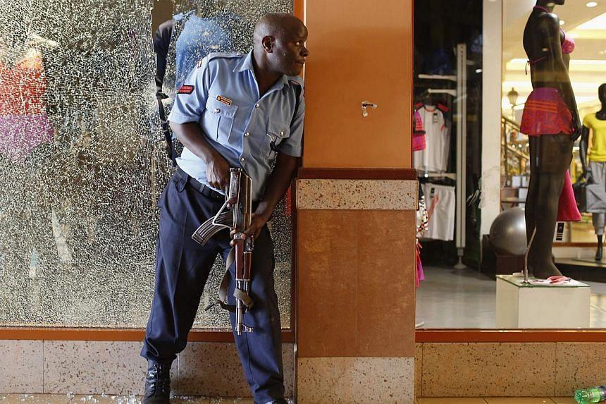 Civilians escape an area at the Westgate Shopping Centre in Nairobi, Sept 21, 2013. -- PHOTO: REUTERS