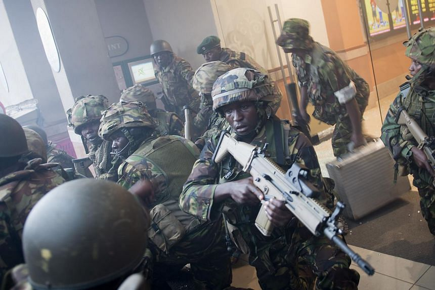 Armed police leave after entering the Westgate Mall in Nairobi, Kenya Saturday, Sept 21, 2013. -- PHOTO: