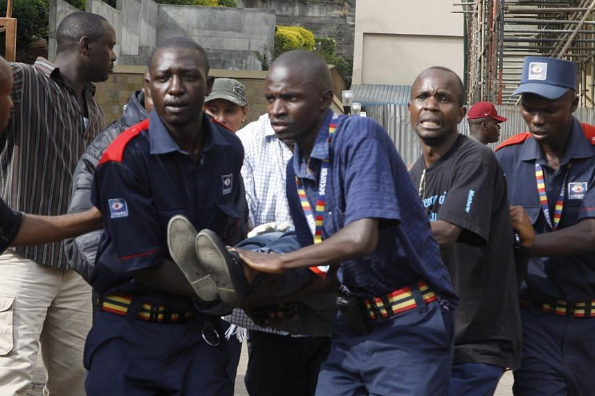 Security helps a wounded woman outside the Westgate Mall in Nairobi, Kenya Saturday, Sept. 21, 2013, after gunmen threw grenades and opened fire during an attack that left multiple dead and dozens wounded. -- PHOTO: AP