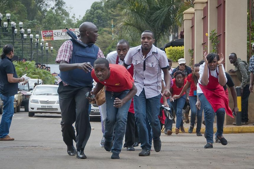 Civilians who had been hiding inside during gunbattles manage to flee from the Westgate Mall in Nairobi, Kenya Saturday, Sept 21, 2013. -- PHOTO: AP