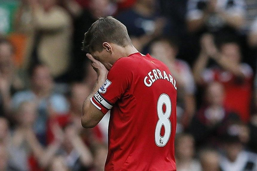 Liverpool's Gerrard wipes his face as he leaves the pitch following their English Premier League football match against Southampton at Anfield in Liverpool. -- PHOTO: REUTERS