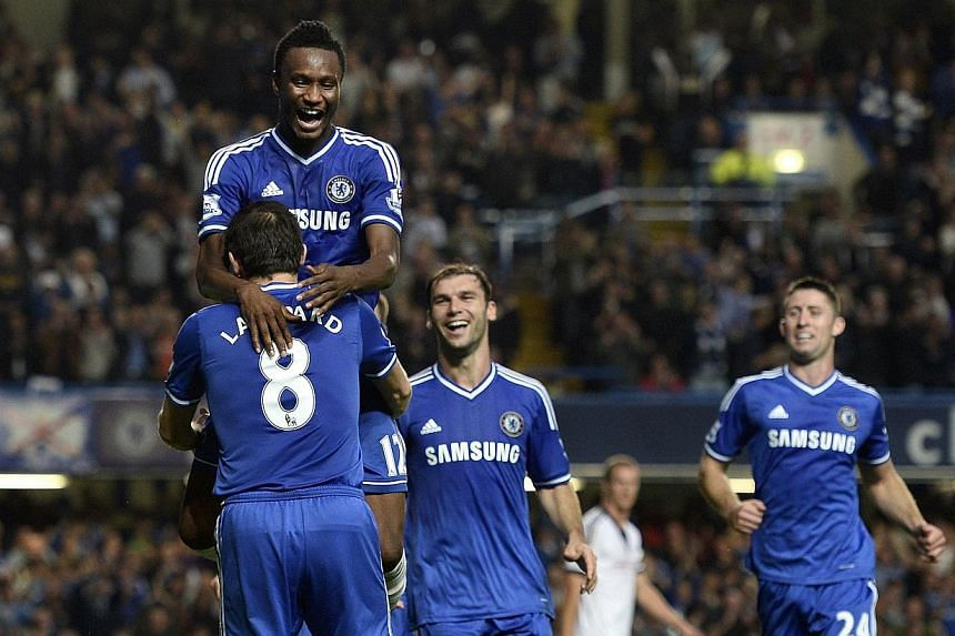 Chelsea's John Obi Mikel (centre) celebrates after scoring against Fulham during their English Premier League football match in London. -- PHOTO: REUTERS