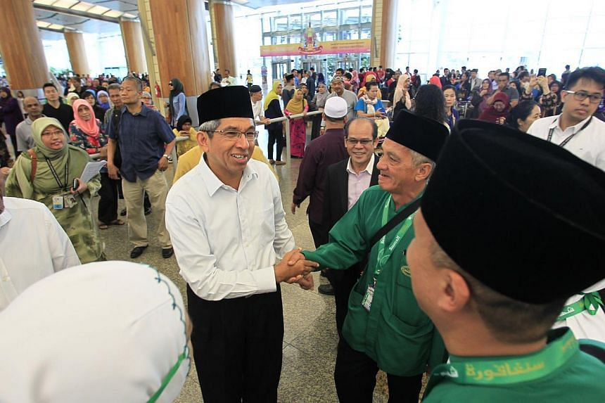 Minister for Muslim Affairs Yaacob Ibrahim with pilgrims embarking on their Haj pilgrimage at Changi Airport on Sunday, Sept 22, 2013.If an appeal by Minister for Muslim Affairs Yaacob Ibrahim to the Saudi Arabian authorities is successful, the