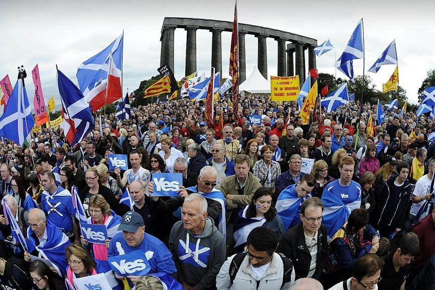 Pro-independence supporters as they gather for a rally in Edinburgh on Sept 21, 2013. -- PHOTO: AFP