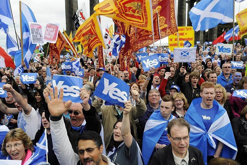 "Pro-independence supporters as they gather for a rally in Edinburgh on Sept 21, 2013. Voting for Scottish independence is ""common sense"", the leader of the movement to break away from the United Kingdom insisted a year to the day befor Scotland votes"