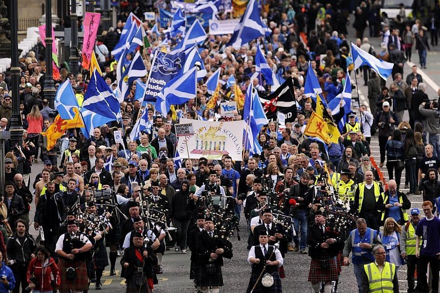 Pro-independence supporters march in Edinburgh on Sept 21, 2013. -- PHOTO: AFP