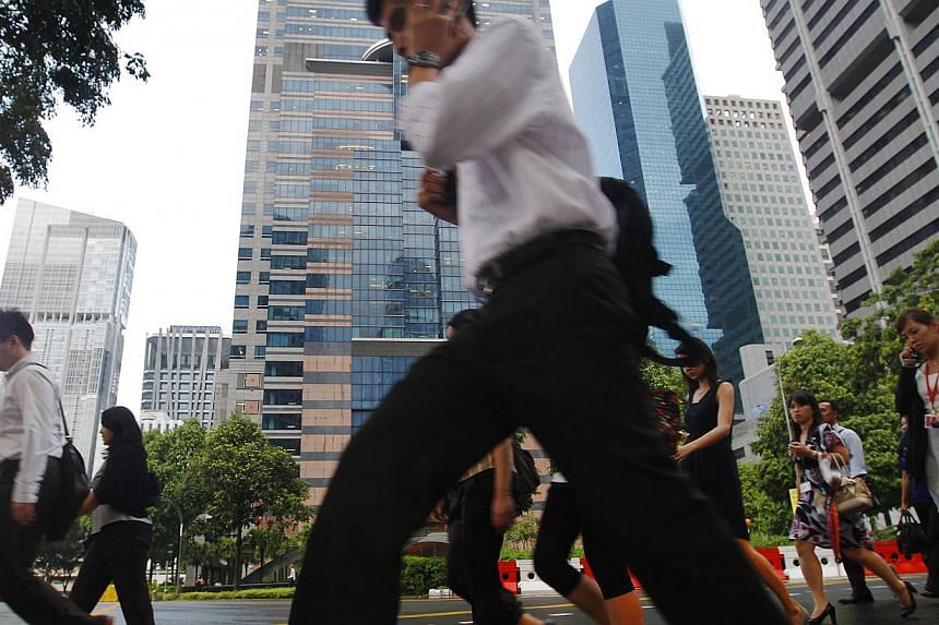 Office workers in Singapore's Central Business District.From Jan 1 next year, the qualifying salaries for all new Employment Pass (EP) applications will be raised to $3,300 from $3,000, in line with rising salaries. -- ST FILE PHOTO : TED CHEN