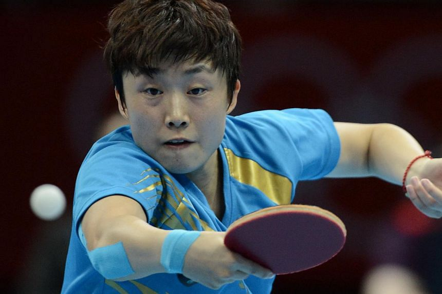 Singapore's Feng Tianwei in action at the London 2012 Olympics on Aug 1, 2012.Singapore's top paddler Feng Tianwei failed to overcome China's world No. 8 Wu Yang in the semi-finals of the table tennis Women's World Cup Monday morning in Kobe, J