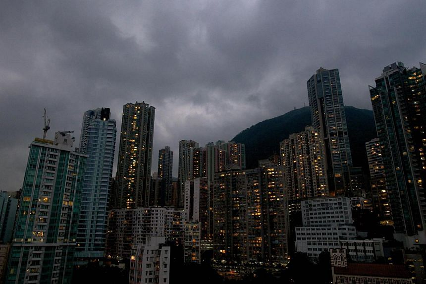 Dark clouds are pictured over the skyline of Hong Kong island as Typhoon Usagi approaches the territory on September 22, 2013. Severe Typhoon Usagi killed at least three people as it smashed into southern China Sunday, shutting down one of the w