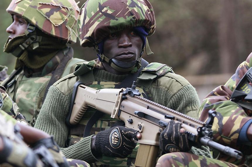 A soldier from the Kenya Defence Forces (KDF) holds his gun as he arrives at the Westgate Shopping Centre in the capital Nairobi September 22, 2013.Most of the hostages trapped in a Nairobi shopping mall by Islamist gunmen have now been r