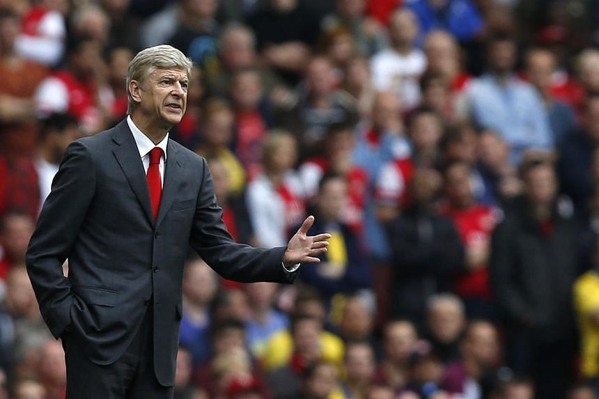 Arsenal's manager Arsene Wenger gestures as he watches his team play Stoke during the English Premier League soccer match between Arsenal and Stoke City at Emirates Stadium in London, Sunday, Sept. 22, 2013.Arsene Wenger believes there is more