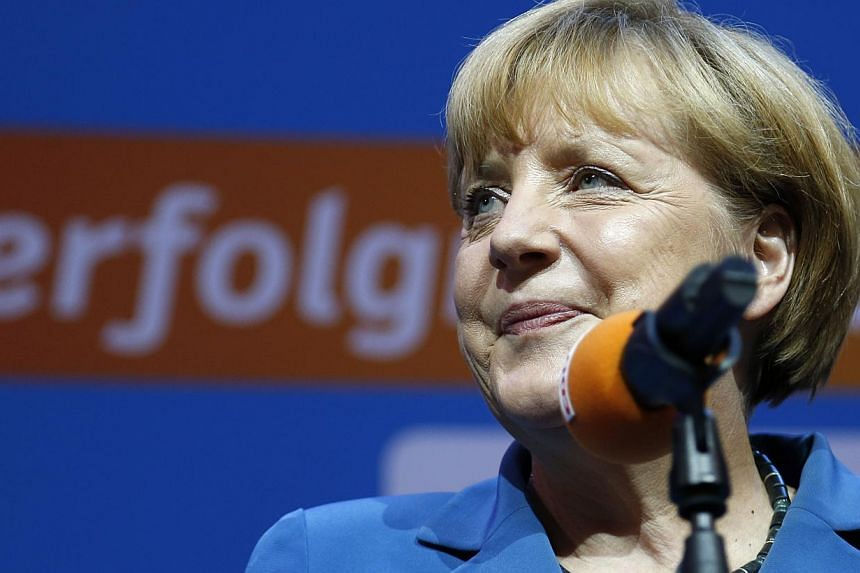 German Chancellor Angela Merkel, chairwoman of the Christian Democratic party CDU, smiles at the party headquarters in Berlin Sunday, Sept. 22, 2013.Congratulations poured in from France and Angela Merkel's other European partners on Sunday aft
