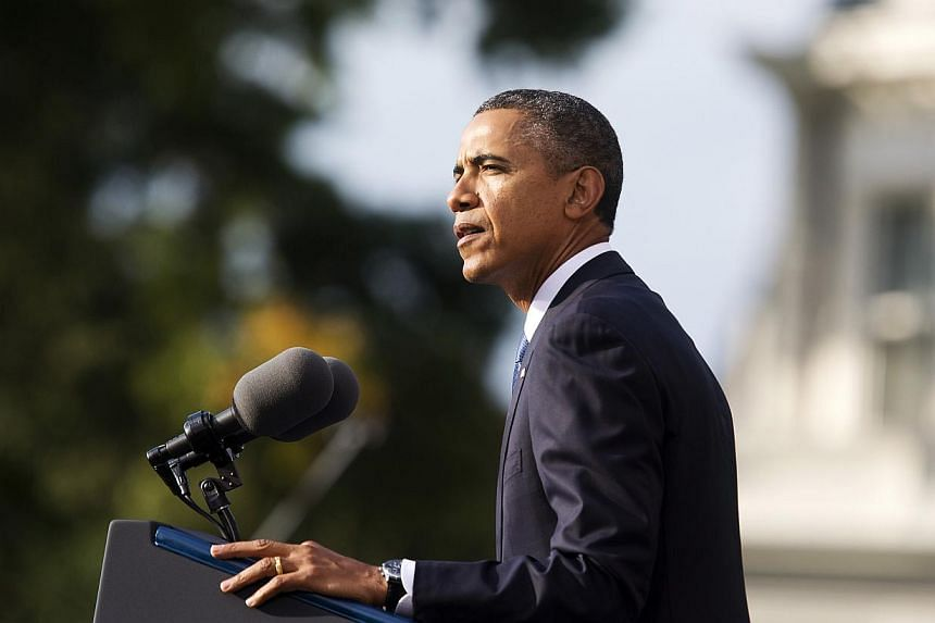 U.S. President Barack Obama speaks at a memorial service after visiting families of victims of the Washington Navy Yard shooting at Marine Barracks in Washington September 22, 2013.President Barack Obama used a memorial service for the victims