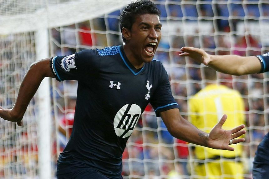 Tottenham Hotspur's Paulinho celebrates after scoring a goal during their English Premier League soccer match against Cardiff City at the Cardiff City Stadium in Cardiff, Wales on Sept 22, 2013. Tottenham Hotspur left it late but made it four wins in