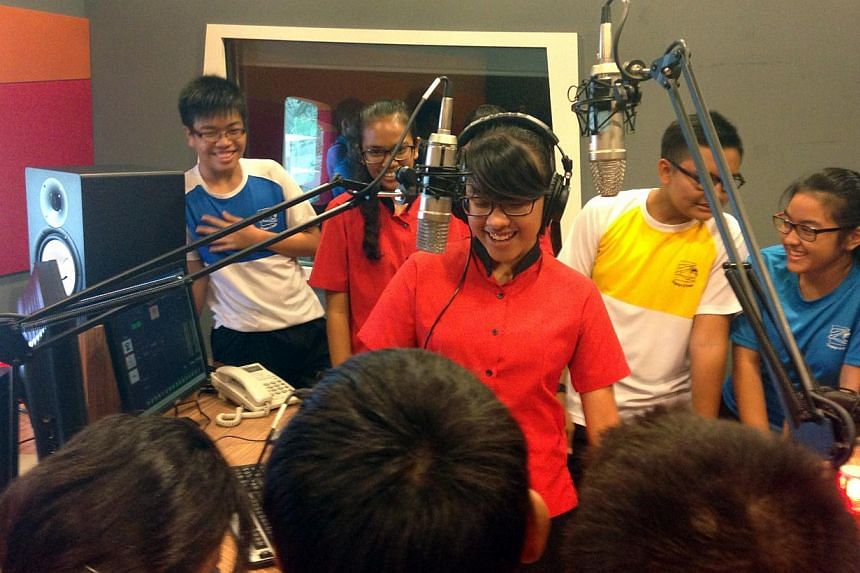 Zhenghua Sec 3 Normal (Academic) student Siti Safwanah Ismail (wearing headphones) learning about sound-mixing at the Singapore Media Academy, as part of a video production module.