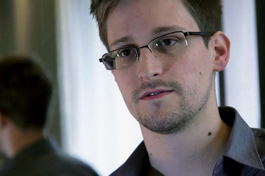 United States intelligence leaker Edward Snowden is living under guard at a secret address in Russia and sometimes emerges in disguise, although he remains in such danger that even a family visit could endanger his security, his lawyer said Monday, S