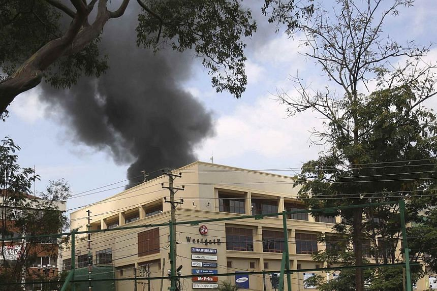 Smoke rises over Westgate shopping centre after an explosion in Nairobi on Monday, Sept 23, 2013. Kenyan security forces are close to ending a Nairobi shopping mall siege, Interior Minister Joseph Ole Lenku said on Monday, with Islamist attacker