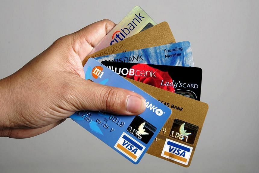 Posed photo of a person holding 6 credit cards to illustrate the story on saying 'no' to credit card debt. More people are now struggling to pay off their credit card bills, new figures show, as if underlining the need for the tough new rules governi