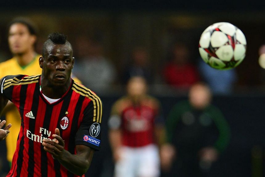 AC Milan's forwards Mario Balotelli eyes the ball during the Champions League football match between AC Milan and Celtic Glasgow, on Sept 18, 2013 in San Siro Stadium in Milan. Balotelli has been suspended for three matches after his red card in the