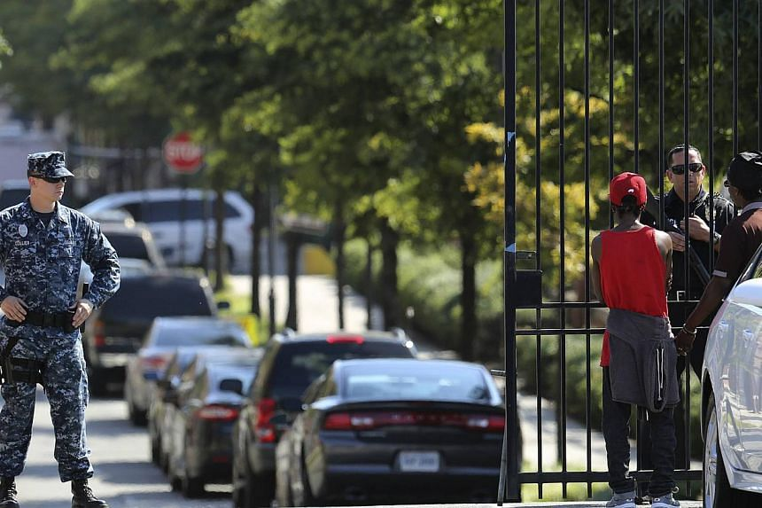 Security personnel check identities at Washington Navy Yard in Washington on Sept 19, 2013. The United States Navy has said it is pushing for more rigorous background checks after a review showed gaps in the case of a former sailor who went on a shoo
