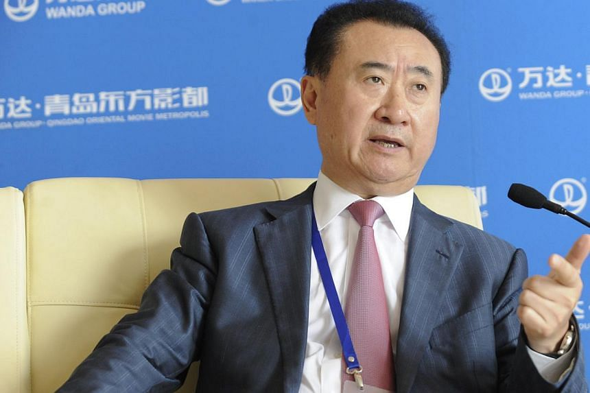 Wanda Chairman Wang Jianlin speaks during a press conference after a launching ceremony of Qingdao Oriental Movie Metropolis in Qingdao, east China's Shandong province, on Sept 22, 2013. An ambitious studio complex built by Mr Wang, China's richest m