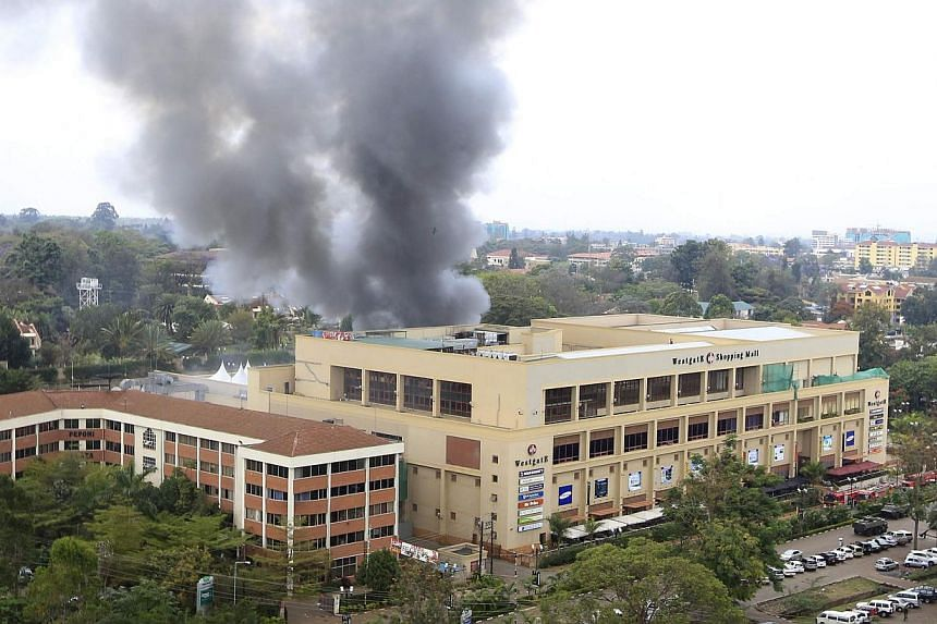 Smoke rises from the Westgate shopping centre after explosions at the mall in Nairobi September 23, 2013.  Kenya said its security forces had taken control of the Nairobi shopping mall where Islamist fighters killed at least 62 people, and