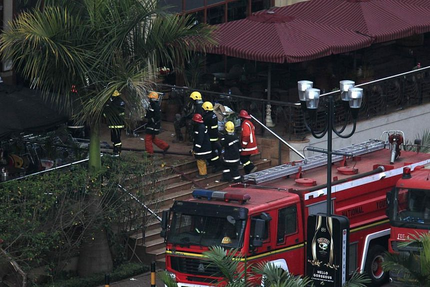 Firefighters enter Westgate shopping centre after explosions at the mall in Nairobi September 23, 2013.  Kenya said its security forces had taken control of the Nairobi shopping mall where Islamist fighters killed at least 62 people, and th