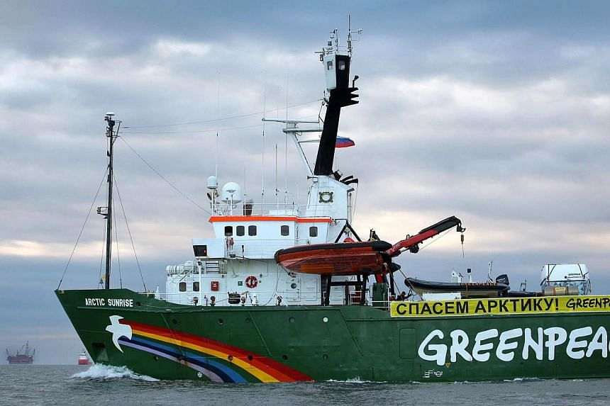 A picture taken by Greenpeace shows the Arctic Sunrise making its way somewhere off Russia's north-eastern coast in the Pechora Sea on Sept 17, 2013. Russia on Tuesday, Sept 24, 2013, opened a piracy probe over a Greenpeace protest against the A