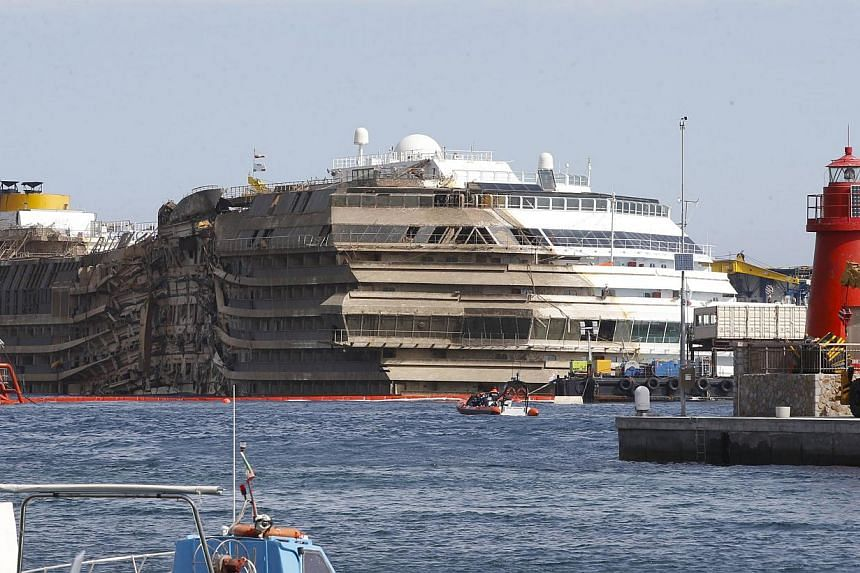 The cruise liner Costa Concordia is seen at the end of the parbuckling operation outside Giglio harbour on Sept 17, 2013.The search for two bodies still missing 20 months after Italy's Costa Concordia cruise ship tragedy began on Tuesday, Sept