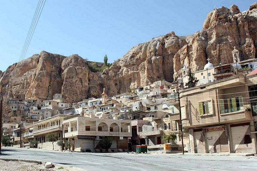 Nearly 40 nuns and orphans are trapped inside a convent in the Syrian Christian town of Maalula, where regime troops are battling rebel forces, the Greek Orthodox Patriarchate said on Tuesday, Sept 24, 2013. -- FILE PHOTO: AFP