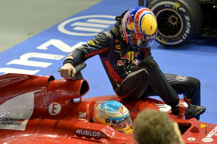 """Red Bull driver Mark Webber has branded the reprimand he was given for hitching a ride on Fernando Alonso's Ferrari after the Singapore Grand Prix night race """"comical"""". -- ST PHOTO:CAROLINE CHIA"""