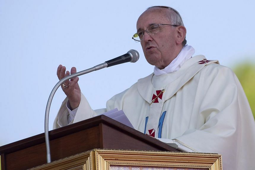 Pope Francis delivers his message at the Sanctuary of the Madonna of Bonaria, to celebrate a mass on the occasion of his one day visit to the island of Sardinia, in Cagliari, Italy on Sunday, Sept 22, 2013.Pope Francis urged countries on Tuesda