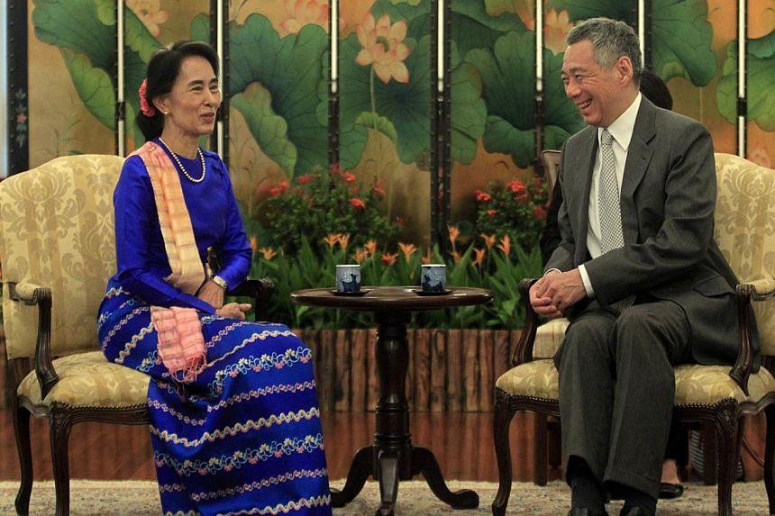 Ms Suu Kyi meeting Prime Minister Lee Hsien Loong at the Istana yesterday. They discussed Myanmar's development, and PM Lee reaffirmed Singapore's support for Myanmar's chairmanship of Asean next year.