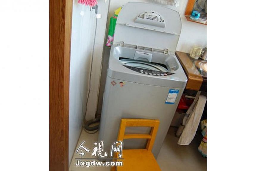 According to a Chinese online news site, this washing machine with a small chair next to it was seen in the kitchen of the girls' home.-- PHOTO: JXGDW.COM