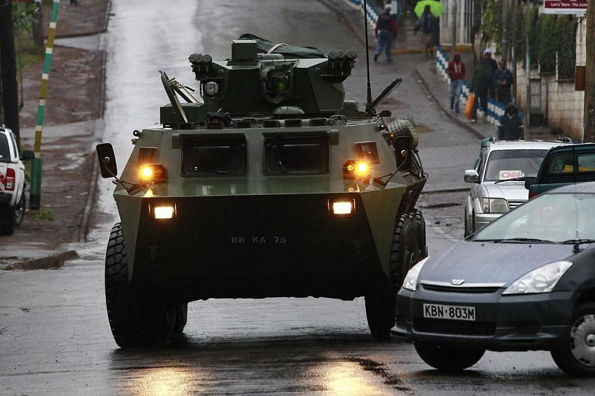 A Kenya Defence Forces armoured military vehicle drives to the Westgate shopping centre after an exchange of gunfire inside the mall in Nairobi on Tuesday, Sept 24, 2013. -- PHOTO: REUTERS