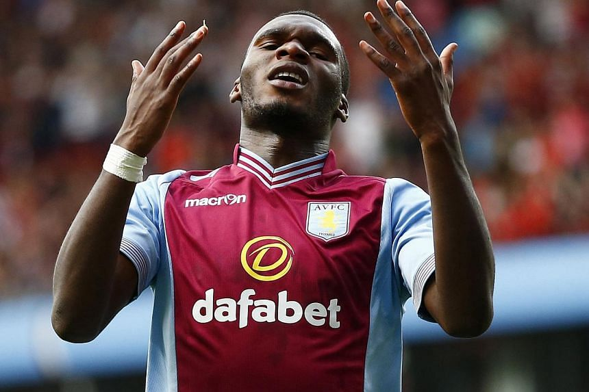 Aston Villa's Christian Benteke reacts after missing a chance to score during their English Premier League soccer match against Liverpool at Villa Park in Birmingham, central England, August 24, 2013.  Aston Villa manager Paul Lambert revealed o