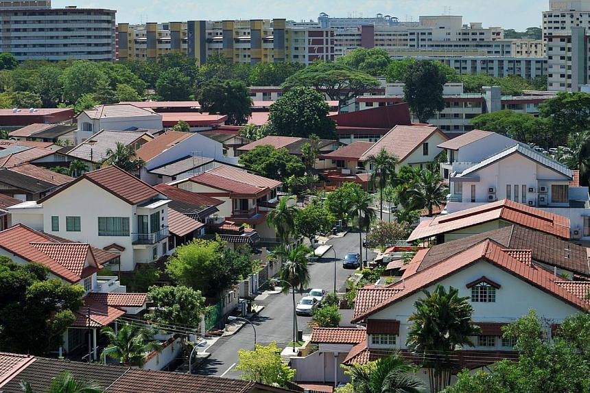 Houses in Mayflower Gardens with HDB blocks in Ang Mo Kio in the background. Fewer speculators have been snapping up Housing Board resale flats following a rule change designed to keep them out of the market. -- ST FILE PHOTO: ALPHONSUS CHE