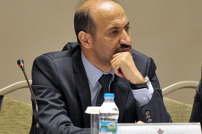 The newly elected chief of the Syrian National Council Ahmad Jarba attends a meeting of the National Coalition of Syrian Revolution and Opposition forces on Sept 13, 2013, in Istanbul. Syrian opposition leaders on Tuesday openly took issue with the U