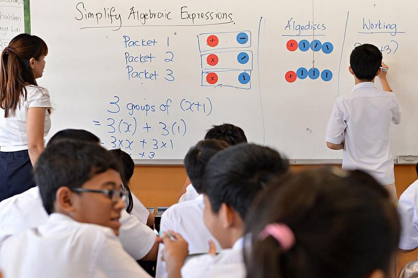 """Algebra is taught using """"Algediscs"""" at a Secondary 2 Normal Technical class at Bedok View Secondary School. The Education Ministry (MOE) has announced several new initiatives to promote the all-rounded development of students. -- ST FILE PHOTO: NURIA"""
